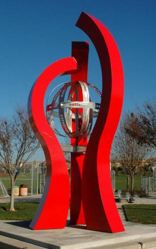 """Huddle""San Remon CA.22 feet tall Kinetic element in the center with words of sportsmanship."